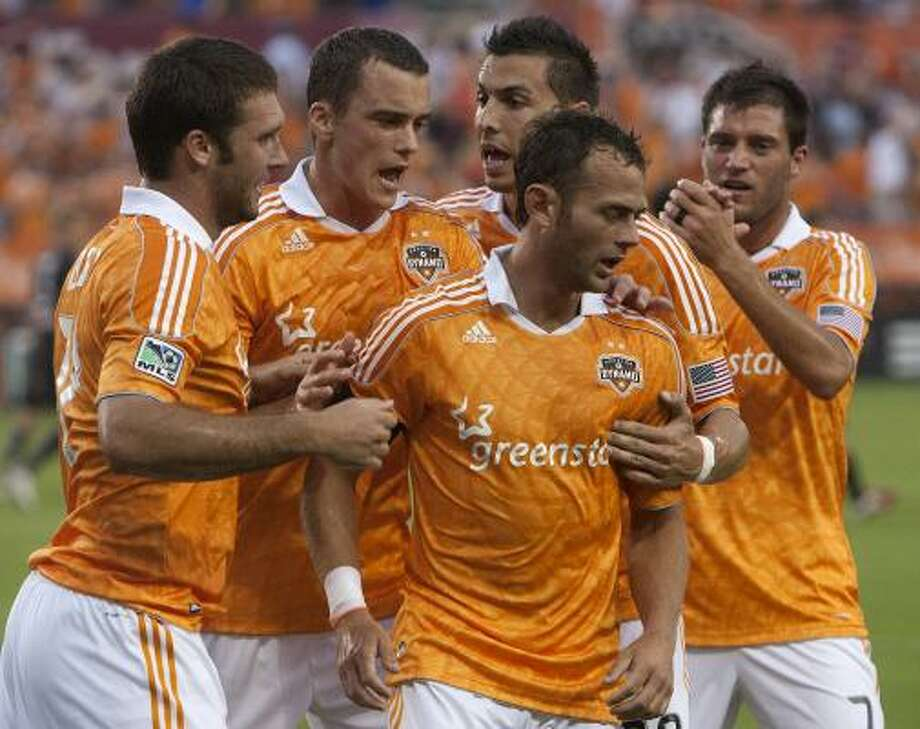 May 21: Dynamo 2, Red Bulls 2 Dynamo midfielder Brad Davis, center, is congratulated by teammates after scoring a goal in the first half of Saturday's match against the New York Red Bulls at Robertson Stadium. Photo: Cody Duty, Chronicle