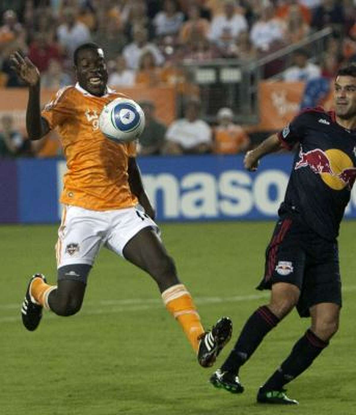 Dynamo midfielder Je-Vaughn Watson, left, loses control of the ball in the second half.