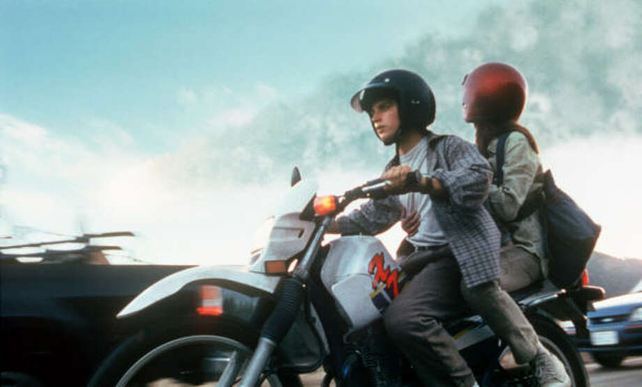 Deep ImpactElijah Wood and Leelee Sobieski play teen-age lovers who try to escape the chaos that erupts when it is revealed that a huge comet is on a deadly collision course with Earth. Photo: Paramount Pictures