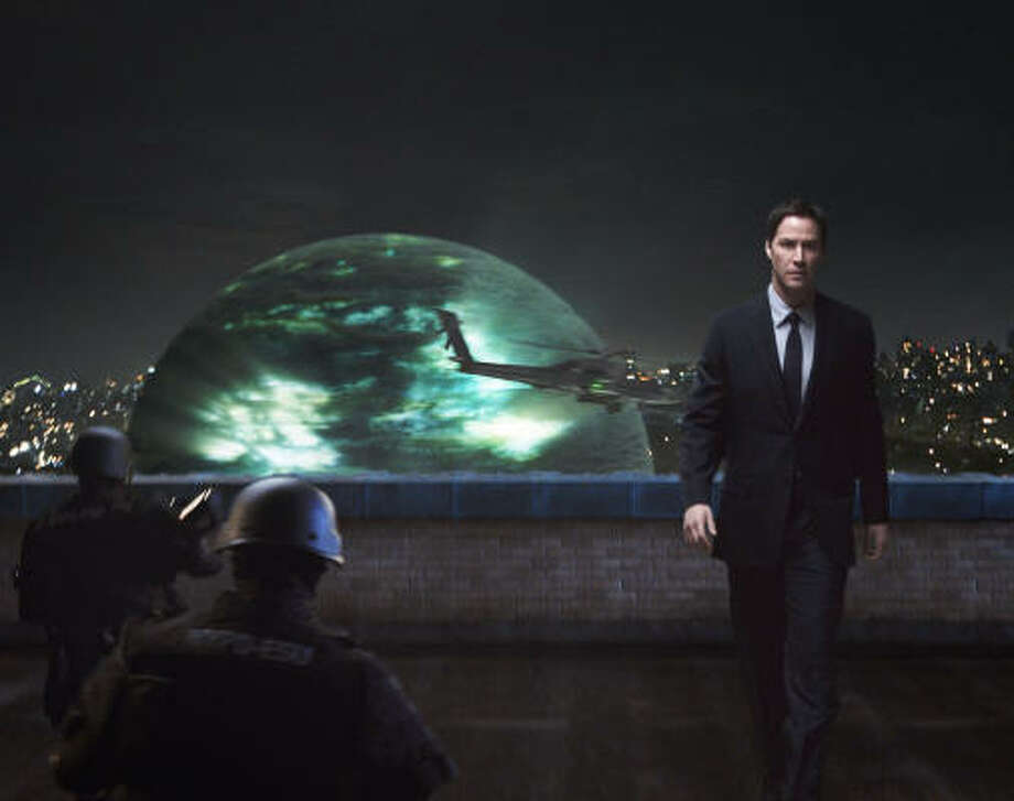 The Day the Earth Stood Still Klaatu's arrival on Earth via a giant sphere, triggers a global upheaval. This shot shows Keanu Reeves in the 2008 remake of the 1951 film. Photo: Twentieth Century Fox