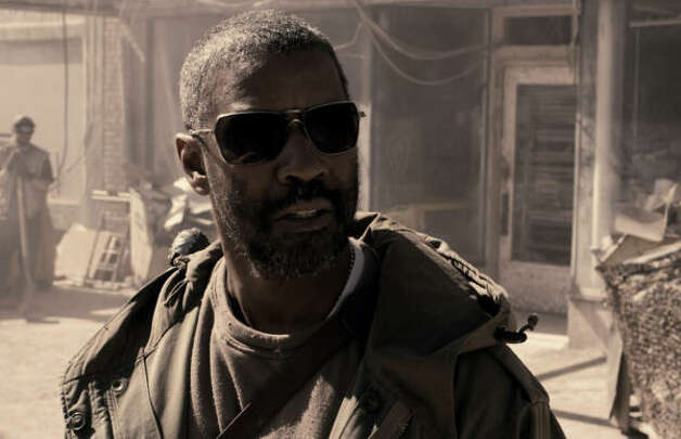Book of  EliDenzel Washington plays Eli, left to protect a sacred book following the apocalypse. Photo: Photo Courtesy Of Warner Bros. P, Warner Bros. Pictures