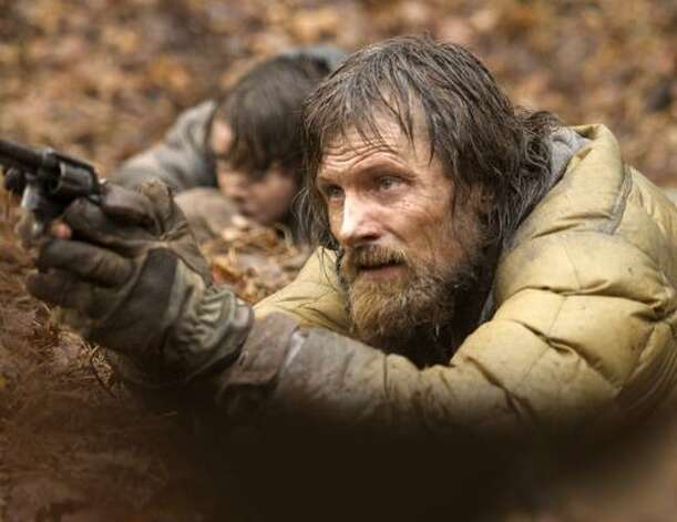 The RoadA father and son pair travel through a ravaged, post-apocalyptic America, fending off looters and cannibals. Photo: Handout, MCT