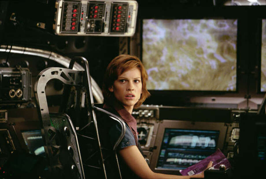The CoreAn astronaut (Hilary Swank) participates in a dangerous mission to burrow into the core of the Earth to set it spinning again. Photo: TM/Paramount Pictures C2003