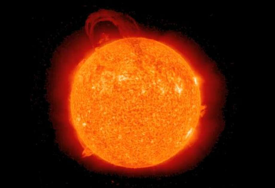 """Solar stormsA NASA rep warned that """"The sun is waking up from a deep slumber, and in the next few years we expect to see much higher levels of solar activity."""" It's probably not a good thing; the storms could threaten communication devices on earth and send solar particles into space.  Perhaps these are the """"signs in the sun"""" referenced in the Gospel of Luke. Photo: AP"""