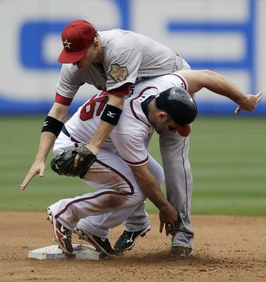 May 17: Braves 3, Astros 1 (11)  Atlanta Braves' Dan Uggla, bottom, collides with Houston Astros shortstop Clint Barmes, right, on a double play hit into by Atlanta Braves' Eric Hinske during the fourth inning Tuesday. Photo: David Goldman, Associated Press