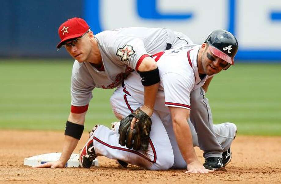 May 17: Braves 3, Astros 1 (11)    Atlanta's Dan Uggla tries to break up a double play as he slides into Houston's Clint Barmes Tuesday. Photo: Kevin C. Cox, Getty