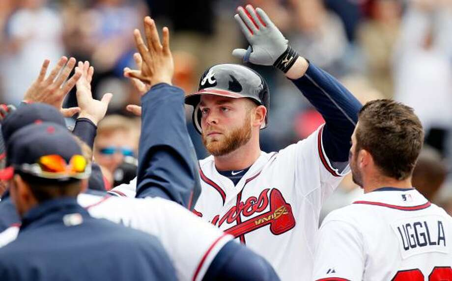 May 17: Braves 3, Astros 1 (11)  Atlanta's Brian McCann celebrates after hitting a solo homer in the bottom of the ninth inning to tie the game against Houston on Tuesday. Photo: Kevin C. Cox, Getty