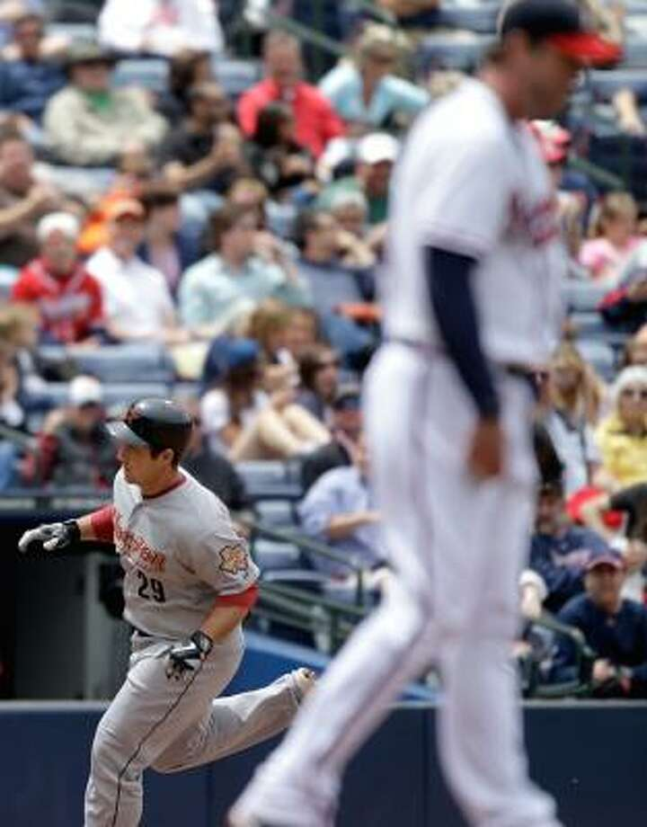 May 17: Braves 3, Astros 1 (11)  Houston's Brett Wallace, left, rounds third base after hitting a home run off Atlanta Braves pitcher Derek Lowe, right, in the seventh inning Tuesday. Photo: David Goldman, Associated Press