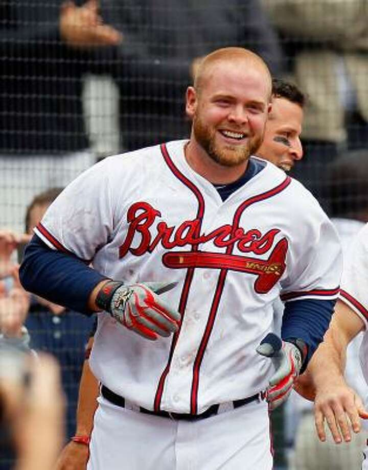 May 17: Braves 3, Astros 1 (11)  Atlanta's Brian McCann celebrates after hitting a walk-off two-run homer in the 11th inning Tuesday. Photo: Kevin C. Cox, Getty