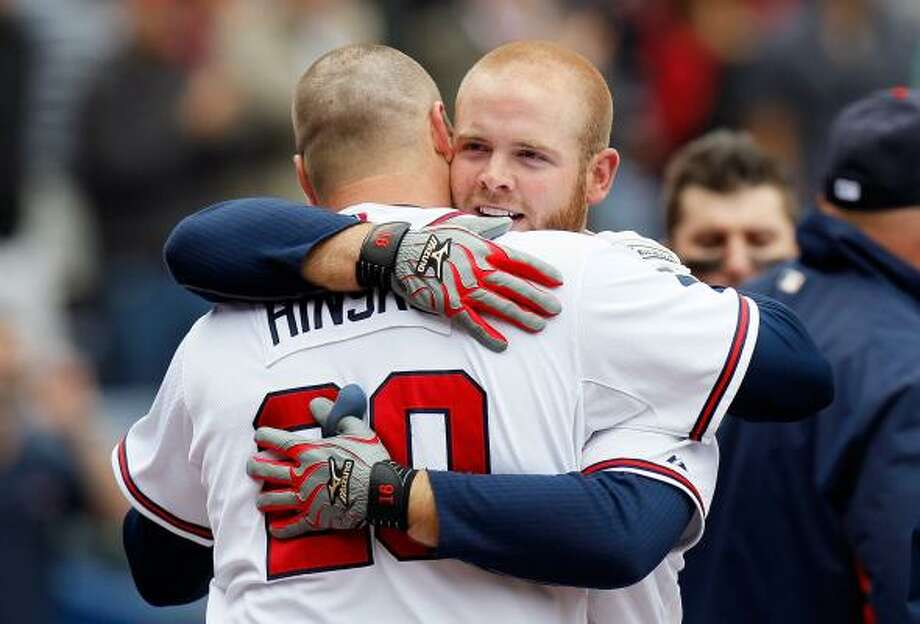 May 17: Braves 3, Astros 1 (11)    Brian McCann celebrates with Eric Hinske after his game-winning home run Tuesday. Photo: Kevin C. Cox, Getty