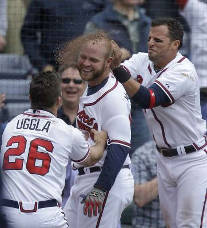 May 17: Braves 3, Astros 1 (11)    Atlanta's Brian McCann, center, has dirt thrown on him by teammate Martin Prado, right, after his game-winning homer Tuesday. Photo: David Goldman, Associated Press