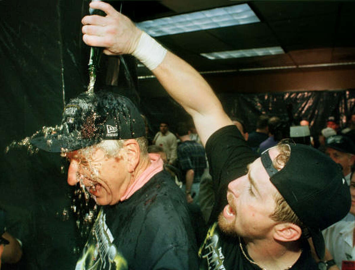 Jeff Bagwell pours champagne on McLane after the Astros' Central Divsion-clinching win over the Cubs in 1997. It was the team's first playoff berth since 1986.