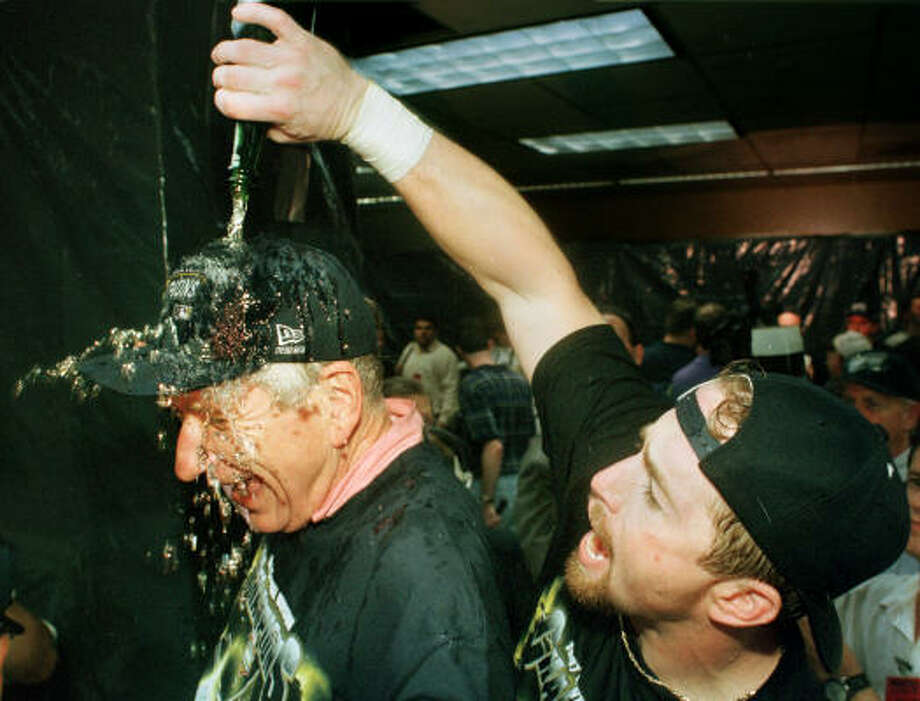 Jeff Bagwell pours champagne on McLane after the Astros' Central Divsion-clinching win over the Cubs in 1997. It was the team's first playoff berth since 1986. Photo: SMILEY N. POOL, Chronicle