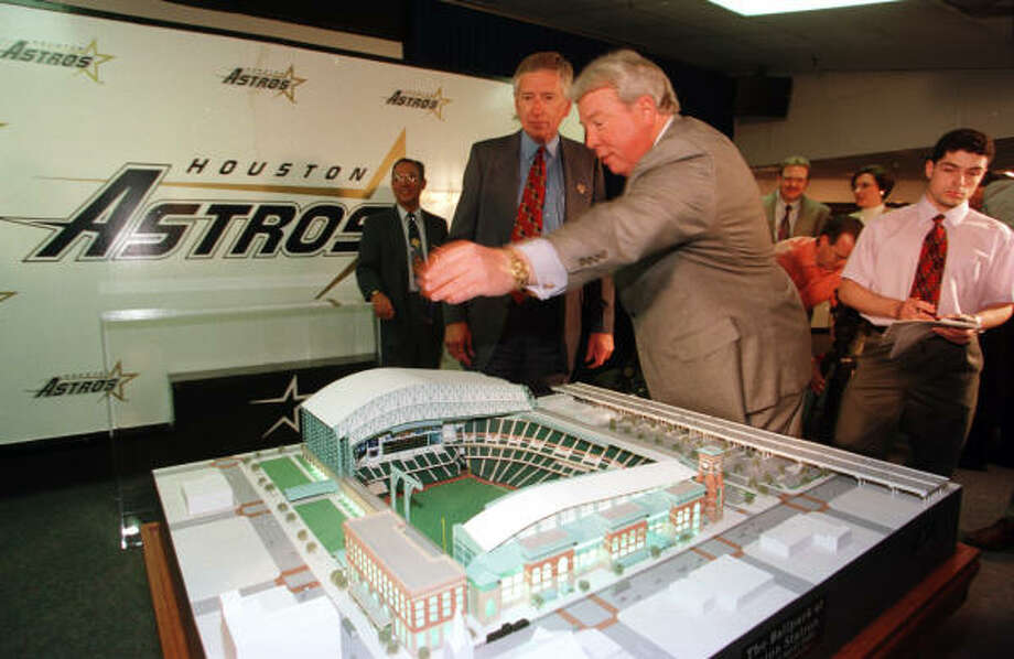 McLane stands with Houston Sports Authority chairman Jack Rains and the scale model of the retractable-roof ballpark under construction downtown. It would be Enron Field, opening in 2000, and later Minute Maid Park. Photo: John Everett, HOUSTON CHRONICLE