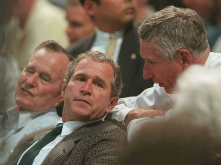 Former president George Bush was joined by his son, then-presidential hopeful George W. Bush, and McLane at the first regular season game at Enron Field in April 2000. Photo: Karen Warren, Chronicle
