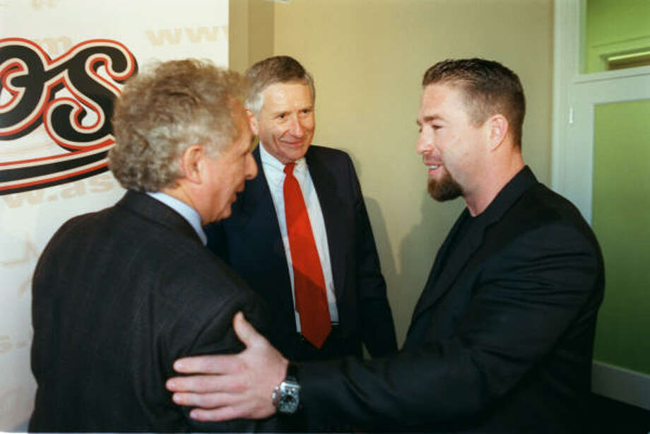 Astros president Tal Smith, left, and McLane greet slugger Jeff Bagwell at Enron Field following the announcement of Bagwell's five-year contract extension. Photo: Steve Ueckert, Chronicle