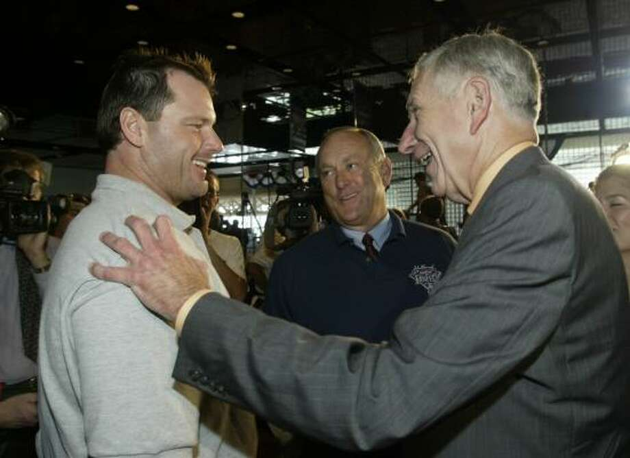 Astros pitcher Roger Clemens, left,  and Hall of Famer Nolan Ryan share a laugh with McLane at the Major League Baseball preview of its All-Star FanFest at the George R. Brown Convention Center in 2004. Photo: John Everett, Chronicle