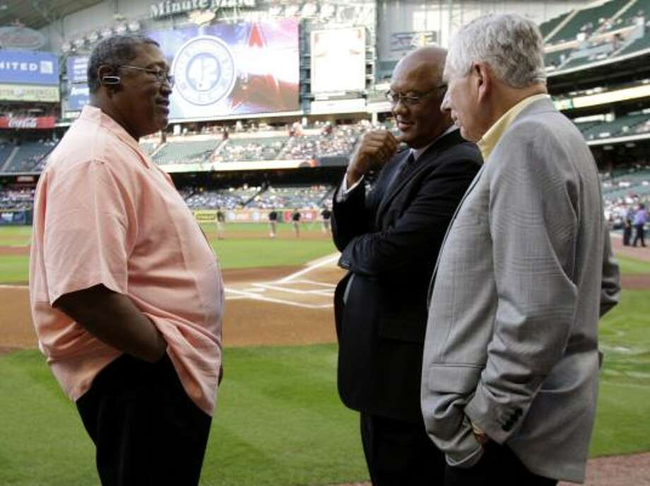 Former Astros J.R. Richard, left, and Enos Cabell talk with Astros owner Drayton McLane, right, before pre-game ceremonies on Jackie Robinson Day at Minute Maid Park on April 15. Photo: Bob Levey, Getty