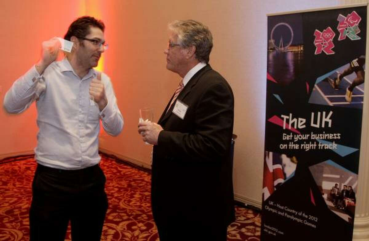 Jeff Boltz of Allocate Software talks to Chris Stappen of ChaiONE at UK Trade & Investment's Annual OTC Celebration at the Hilton Hotel in Houston on May 2, 2011.
