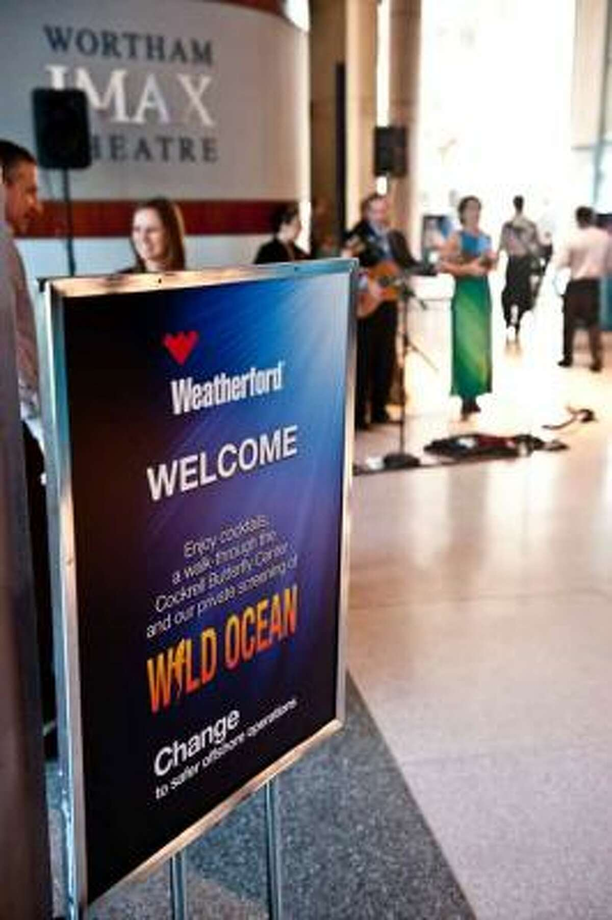 A welcome sign marks the entrance to Weatherford International's Offshore Technology Conference reception, held May 4, 2011 at the Houston Museum of Natural Science.