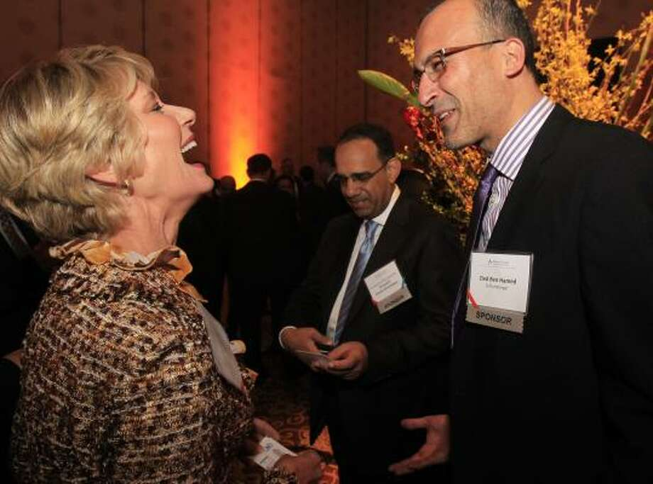 Railroad Commission of Texas Chairman Elizabeth A. Jones laughs as she talks to Zied Ben Hamed, of Schlumberger, right, during the Bilateral US-Arab Chamber of Commerce's 14th Annual Offshore Technology Conference reception at the InterContinental Hotel on May 2, 2011, in Houston. Photo: Cody Duty, Houston Chronicle