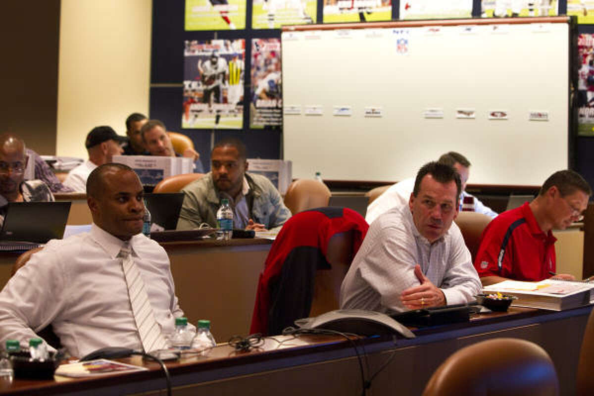 Texans general manager Rick Smith, left, and head coach Gary Kubiak probably left some fans scratching their heads over the team's selections in last week's NFL draft.