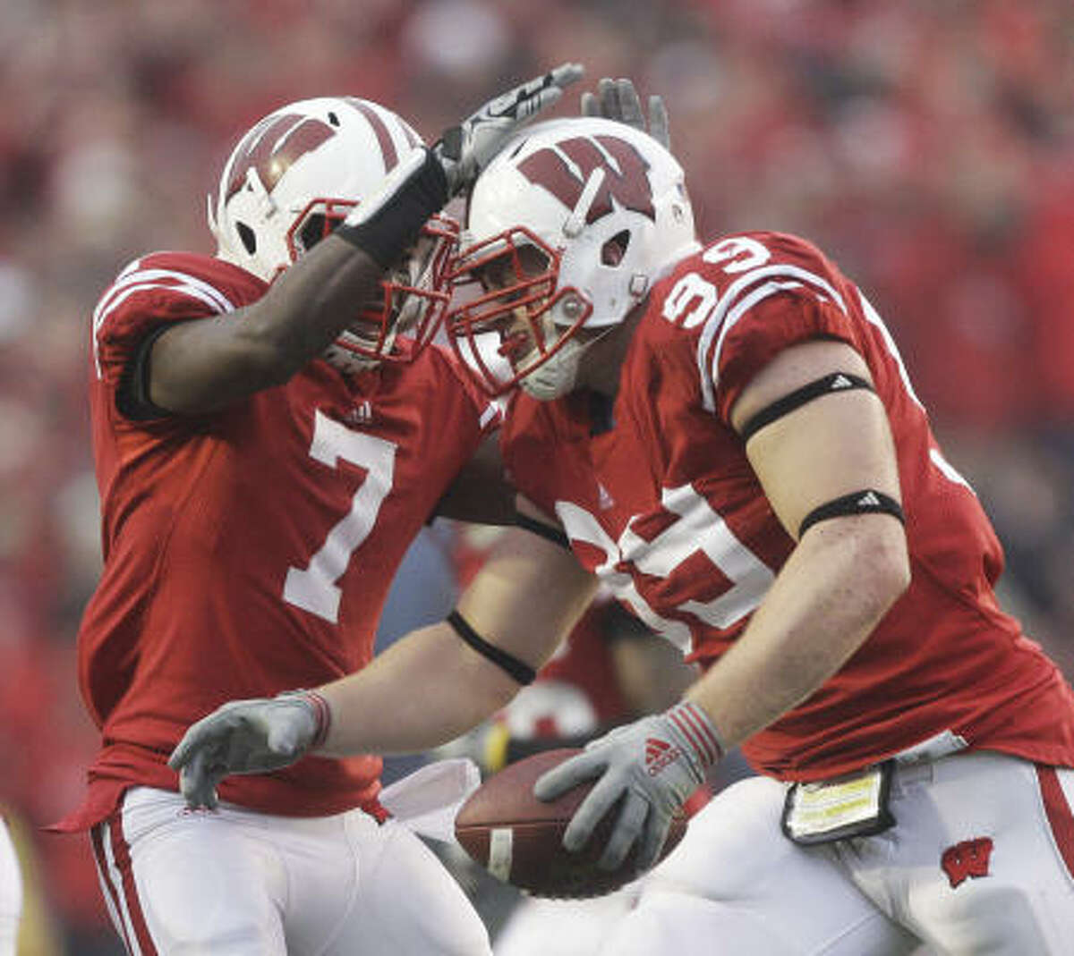 Watt, right, led Wisconsin in tackles for losses, sacks (seven), quarterback hurries, forced fumbles and blocked kicks. He was second on the team in tackles with 59. He also knocked down 13 passes in two years.