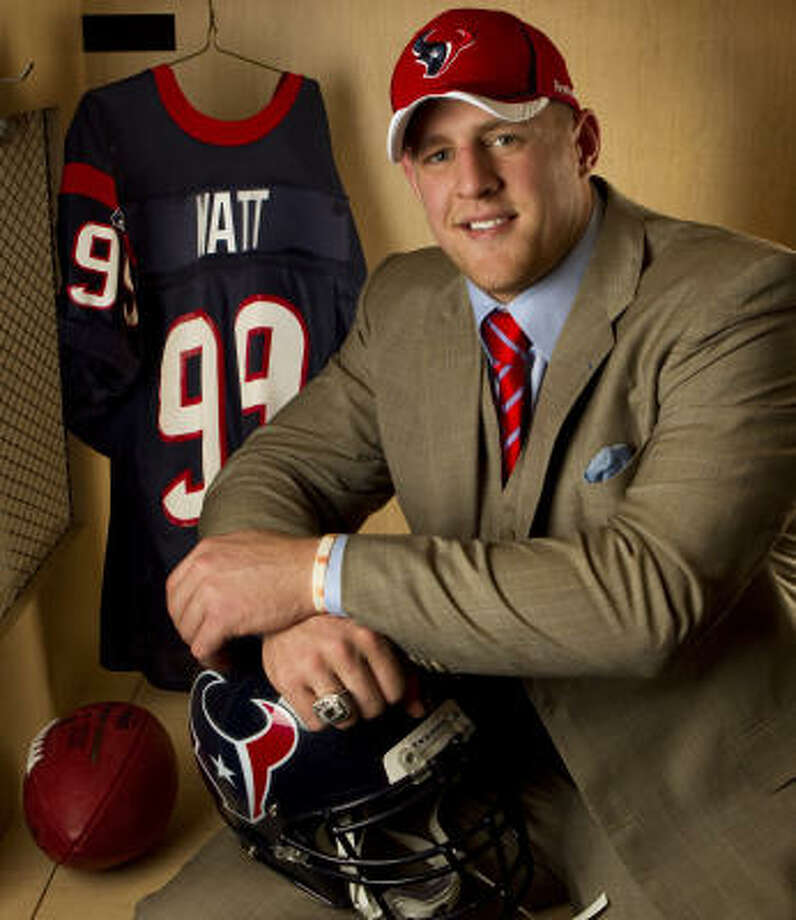 J.J. Watt poses for a portrait at his locker. Photo: Brett Coomer, Chronicle