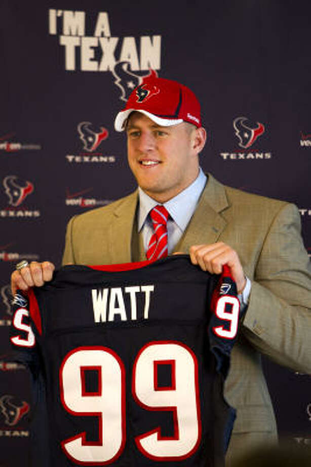 J.J. Watt smiles as he holds his new Texans jersey. Photo: Brett Coomer, Chronicle