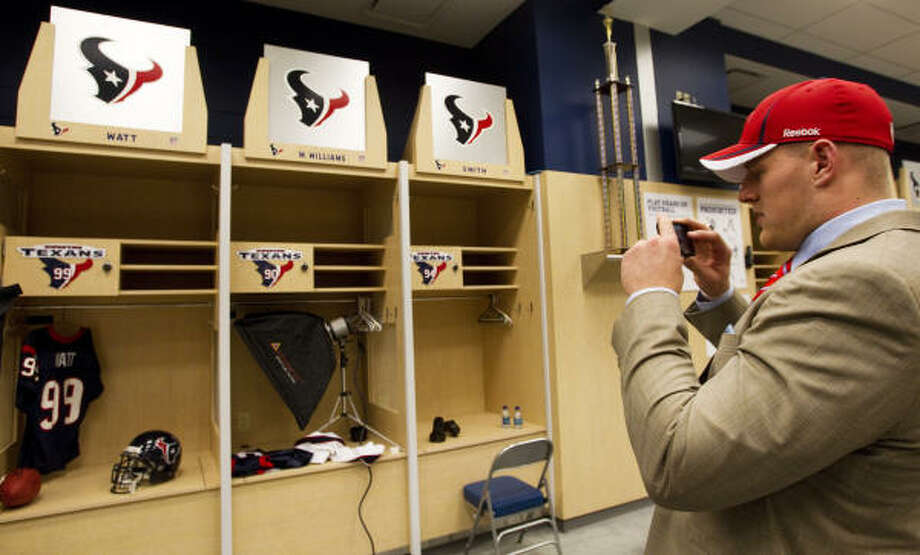 J.J. Watt uses his cell phone to take a photo of his locker. Photo: Brett Coomer, Chronicle