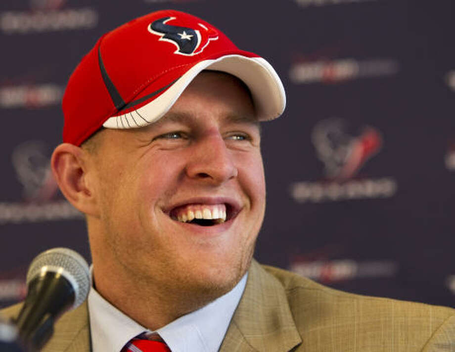 J.J. Watt prepares to field questions at a news conference. Photo: Brett Coomer, AP