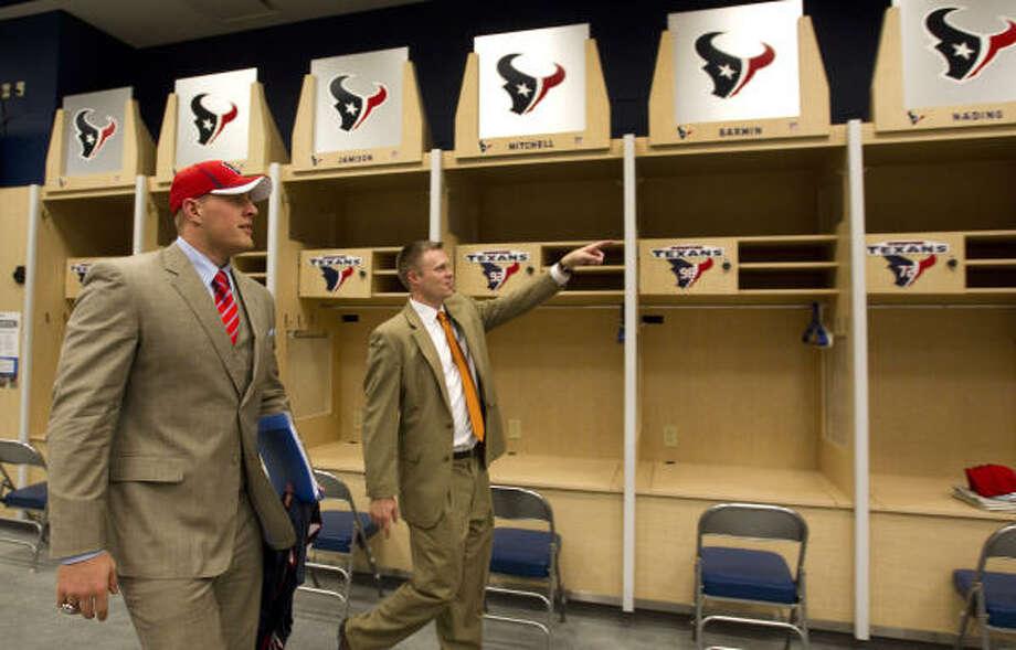 J.J. Watt, left, is shown to his locker by Texans official Zac Emmons. Photo: Brett Coomer, Chronicle