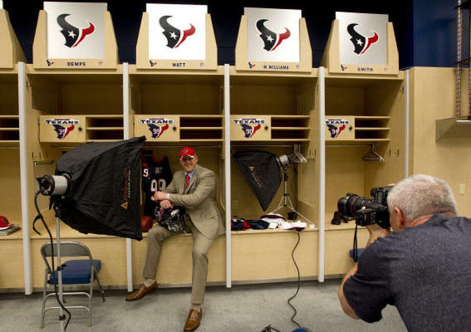 J.J. Watt smiles as he poses for a portrait for Texans team photographer Bill Baptist. Photo: Brett Coomer, Chronicle