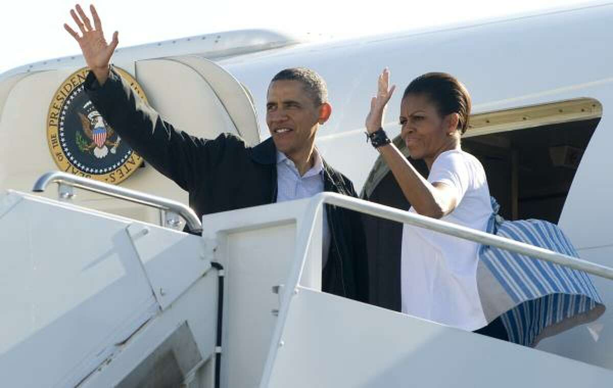 President Barack Obama and first lady Michelle Obama wave from Air Force One prior to departure from Andrews Air Force Base in Maryland, April 29, 2011. Obama is traveling to Tuscaloosa, Alabama, to view tornado damage before continuing to Florida to watch the Space Shuttle Endeavor depart and give the commencement address at Miami Dade College.