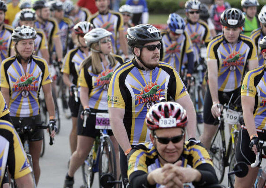 Bicyclists wait to hit the road. Photo: James Nielsen, Chronicle