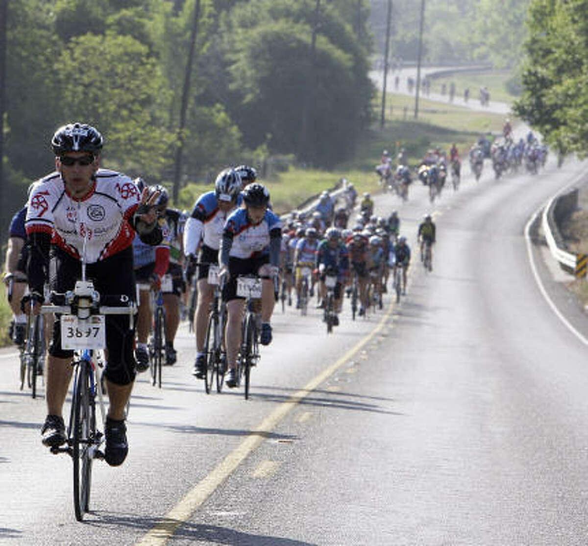 Rider Edward Raudez flashes a peace sign.