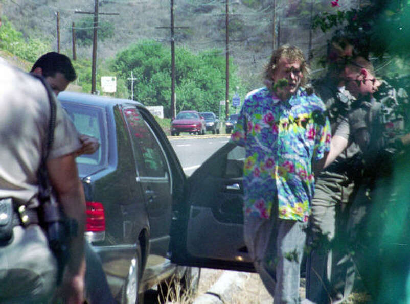 Here is Nick Nolte, second from right, being arrested by California Highway Patrol officers on Pacif