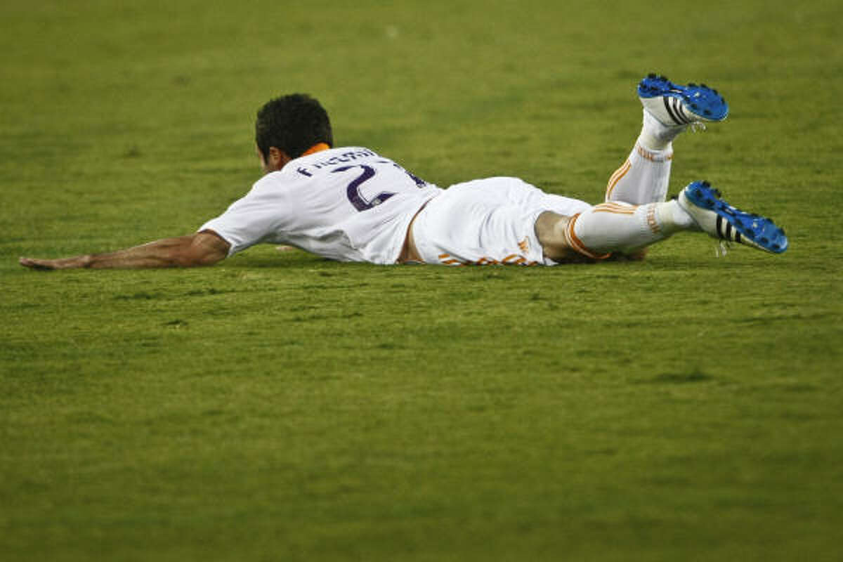 Dynamo defender Hunter Freeman hits the ground in celebration of his goal in the 86th minute.