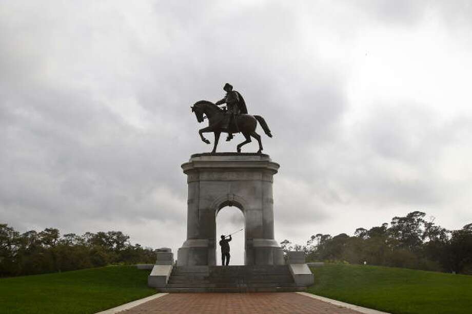 "Aaron Pena of the Houston Parks and Recreation Department sprays down the inside of the Sam Houston Monument in Hermann Park after it was vandalized with graffiti overnight, Tuesday, March 8, 2011, in Houston. The Bronze statue of General Sam Houston riding on horseback was designed by Enrico Cerracio and erected in 1916, as part of the ""City Beautiful Project"". Sam Houston's outstretched arm points eastward, toward the San Jacinto Battlefield where his outnumbered army defeated the forces of General Santa Ana and secured Texas' independence from Mexico. Photo: Michael Paulsen, Chronicle"