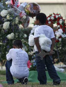 Children stand at the grave of 16-month-old Elias Xavier Castillo after his funeral at Memorial Oaks Funeral Home and Cemetery Friday, March 4, 2011, in Houston. He died in a day care fire that killed four other children. Photo: Melissa Phillip, Houston Chronicle
