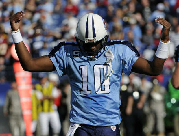 Tennessee Titans quarterback Vince Young waves his hands as fans boo as he leaves the field in the second quarter of an NFL football game against the Washington Redskins on Sunday, Nov. 21, 2010, in Nashville, Tenn. Young later left the game with an injured thumb. Photo: Frederick Breedon, AP