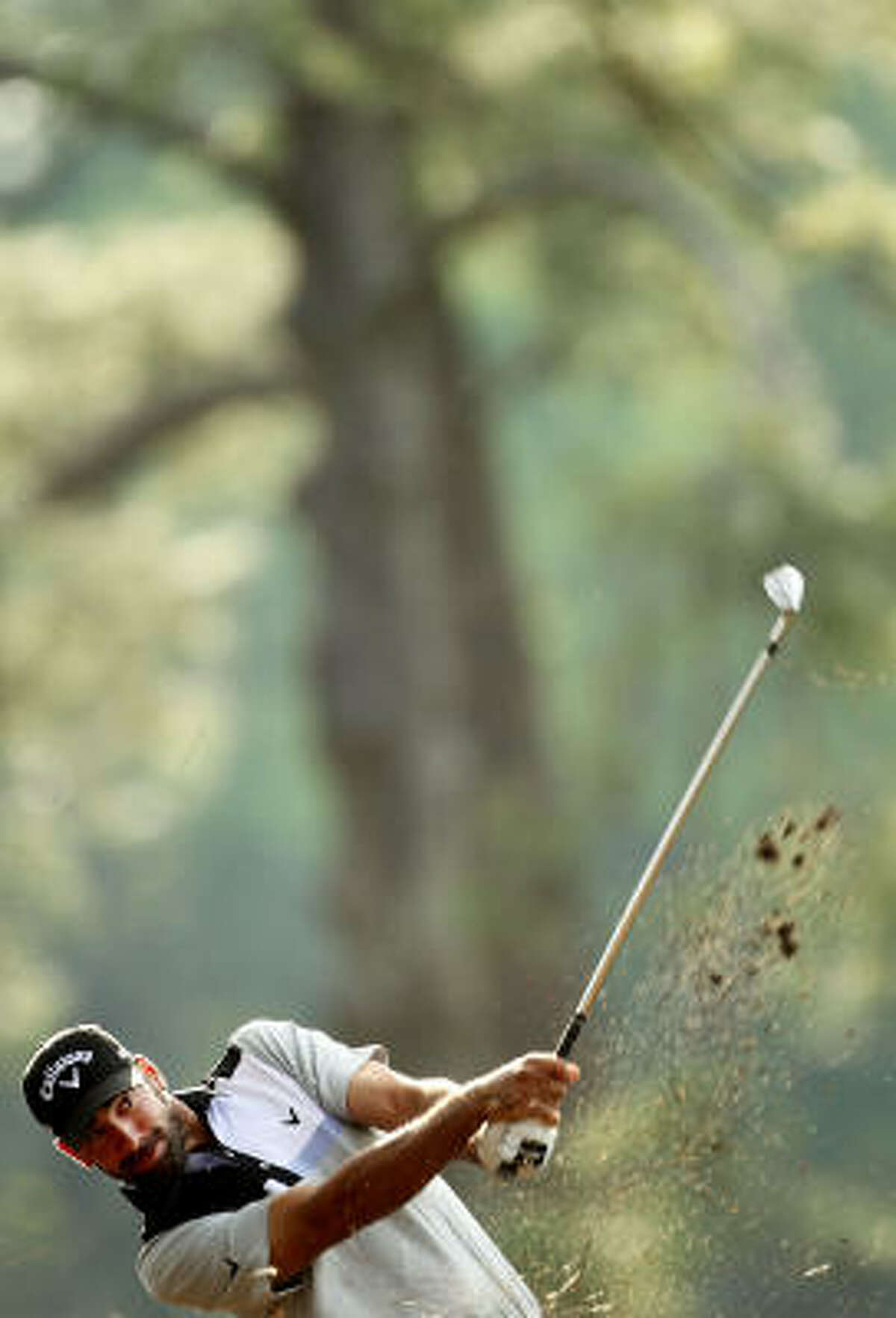 Alvaro Quiros hits his approach shot on the 14th hole.