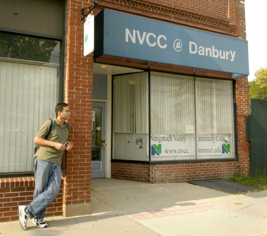 Rafael Hamoy, 23, of New Milford, a first year student, stands outside of the office on Crosby St. in Danbury for Naugatuck Community College, Monday, Sept 28, 2009 Photo: Carol Kaliff / The News-Times