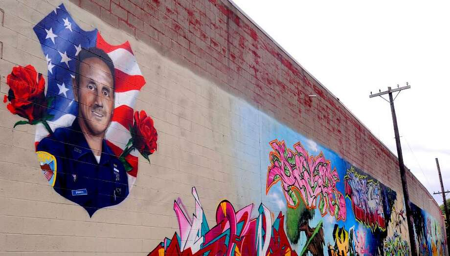 A graffiti tribute to the late Danbury police officer Bobby DiNardo on a wall near the Police Station on Main Street. Photo: Michael Duffy / The News-Times