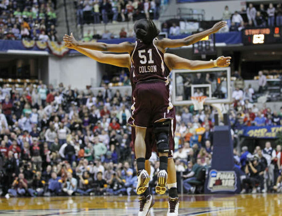 Texas A&M's Sydney Colson (51) celebrates with teammates after their 63-62 win over Stanford. Photo: Michael Conroy, AP