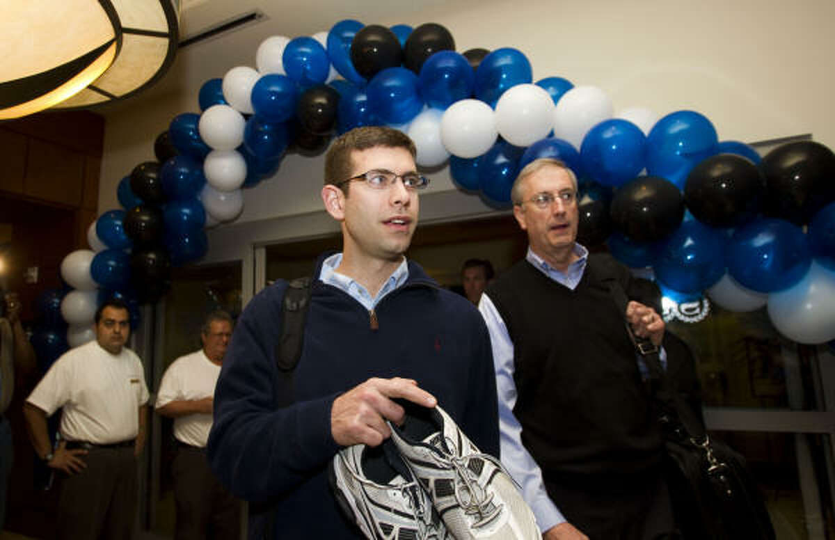 Butler head coach Brad Stevens, left, walks with Sports Information Director Jim McGrath through the front door of the Sheraton Suites.