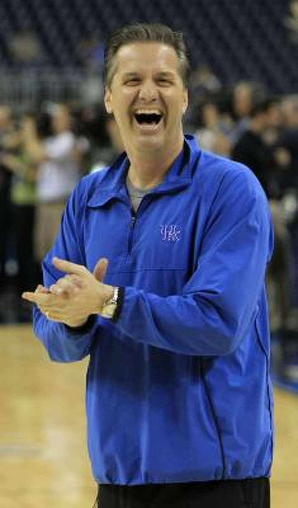 Kentucky head coach John Calipari reacts to his players during Kentucky's practice.
