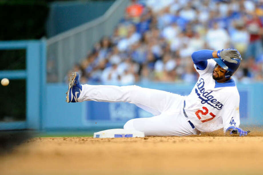 Matt Kemp of the Los Angeles Dodgers slides in safe to second base against the San Francisco Giants on Opening Day at Dodger Stadium. The Dodgers won 2-1. Photo: Kevork Djansezian, Getty Images