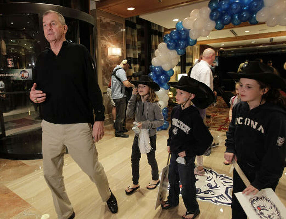 Connecticut head coach Jim Calhoun walks into the lobby of the JW Marriott in the Galleria, surrounded by his grandchildren, as he and the players of UConn arrive at their hotel.