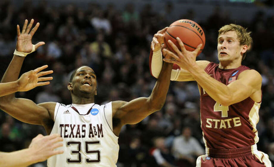 March 18: No. 10 Florida State 57, No. 7 Texas A&M 50 (second round) Texas A&M's Ray Turner and Florida State's Deividas Dulkys fight for a loose ball. Photo: Jim Prisching, AP